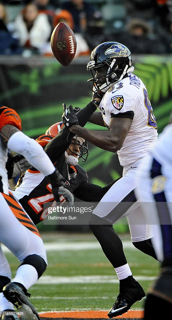 Baltimore Ravens wide receiver Deonte Thompson, right, catches a pass against Cincinnati Bengals' Leon Hall (29), left, in the fourth quarter at Paul Brown Stadium on Sunday, December 30, 2012, in Cleveland, Ohio. The Cincinnati Bengals defeated the Baltimore Ravens, 23-17.
