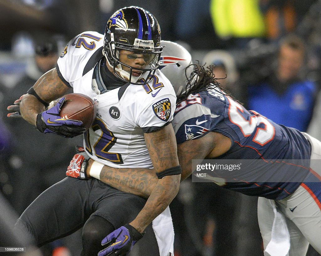 Baltimore Ravens wide receiver Jacoby Jones is brought down by New England Patriots middle linebacker Brandon Spikes during the second half of the AFC Championship game at Gillette Stadium in Foxboro, Massachusetts, Sunday night, January 20, 2013.
