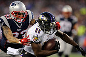 Baltimore Ravens wide receiver Kamar Aiken cannot be stopped by New England Patriots safety Patrick Chung on his way a 19yard touchdown in the first...