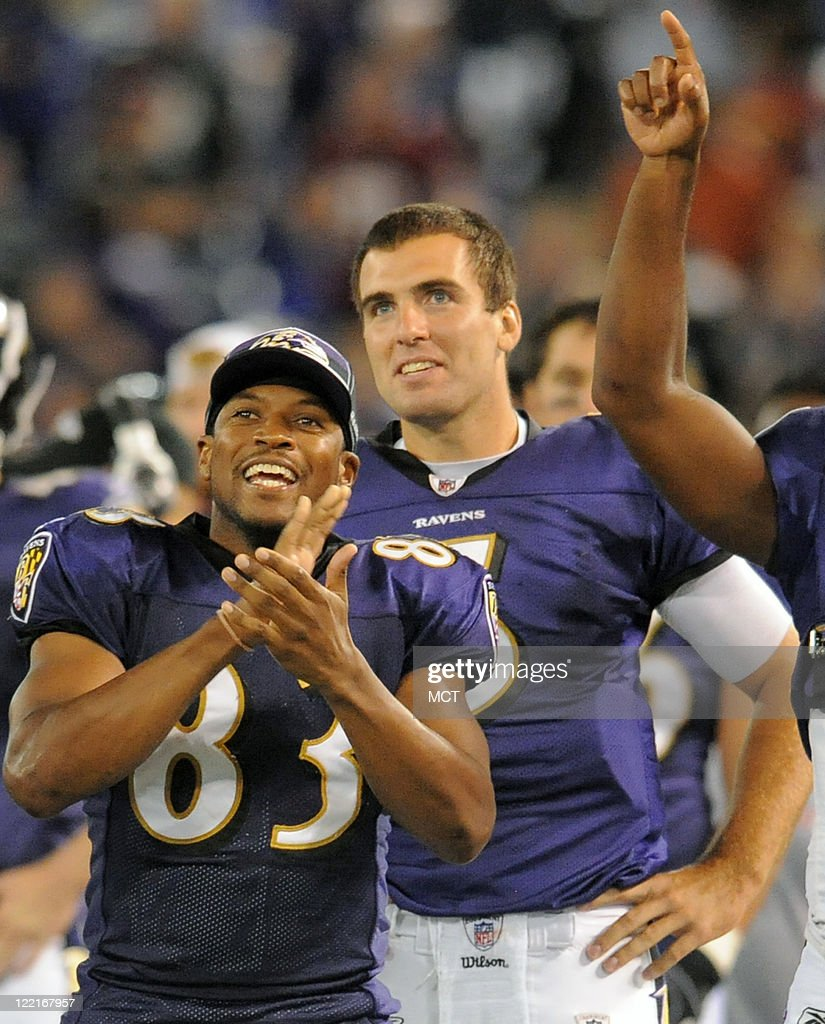 Baltimore Ravens wide receiver Lee Evans (L) and quarterback Joe Flacco watch the second team offense score a touchdown with seconds left. The Baltimore Ravens defeat the Washington Redskins 34-31 in their preseason game on Thursday, August 25, 2011, in Baltimore, Maryland.