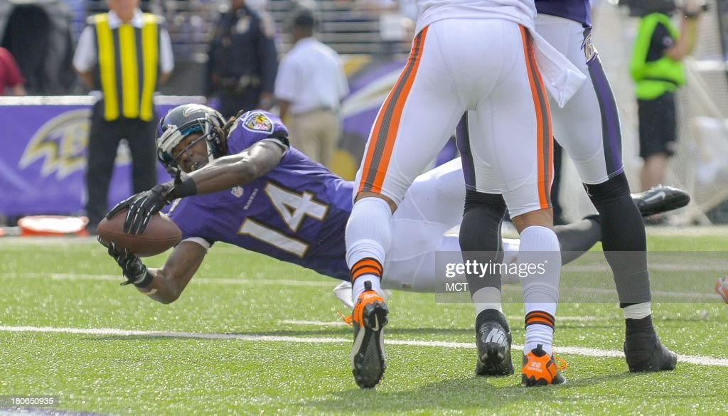 Baltimore Ravens wide receiver Marlon Brown stretches the ball over the goal line after making a reception against the Cleveland Browns during the second half of their game on Sunday, September 15, 2013, in Baltimore, Maryland.