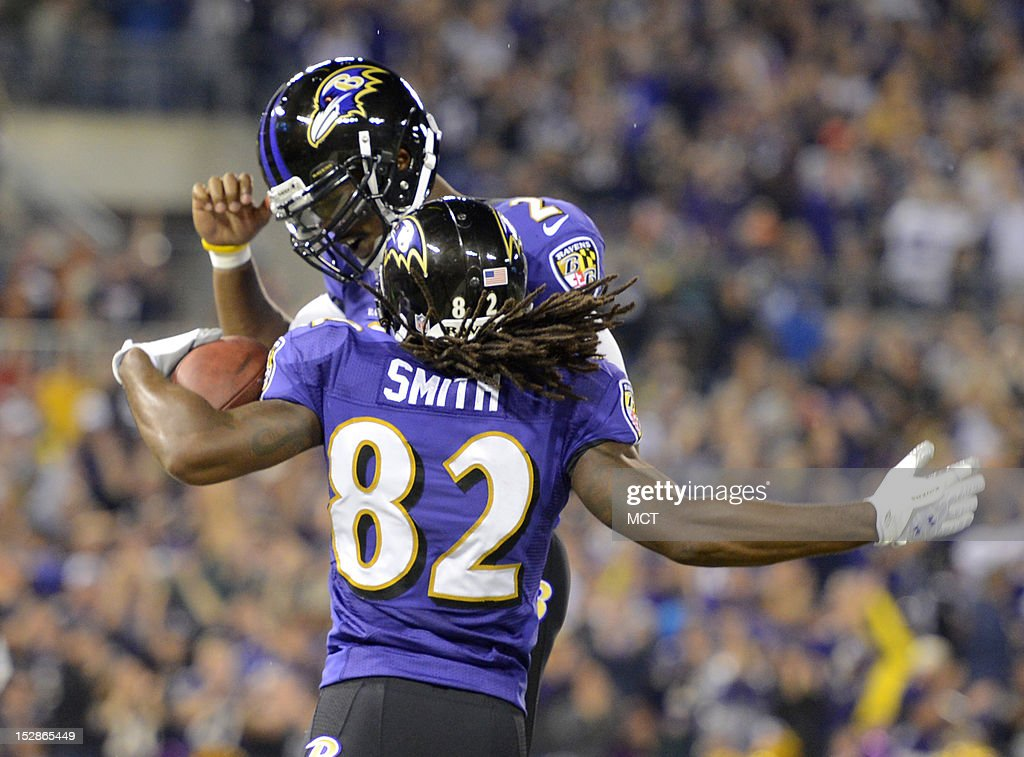 Baltimore Ravens wide receiver Torrey Smith celebrates his touchdown reception with teammate Tyrod Taylor during the first half of their game in Baltimore, Maryland, on Thursday, September 27, 2012.