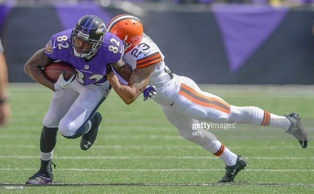 Baltimore Ravens wide receiver Torrey Smith is brought down by Cleveland Browns cornerback Joe Haden after making a reception during the first half of their game on Sunday, September 15, 2013, in Baltimore, Maryland.