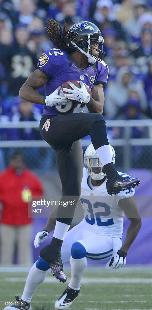 Baltimore Ravens wide receiver Torrey Smith makes a leaping first down reception in front of Cassius Vaughn during the first half of their AFC playoff game in Baltimore, Maryland, on Sunday, January 6, 2013.