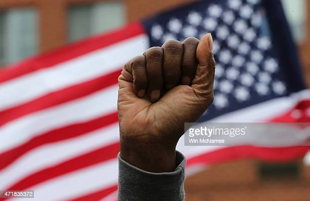 Baltimore residents celebrate at the corner of West North Avenue and Pennsylvania Avenue after Baltimore authorities released a report on the death...