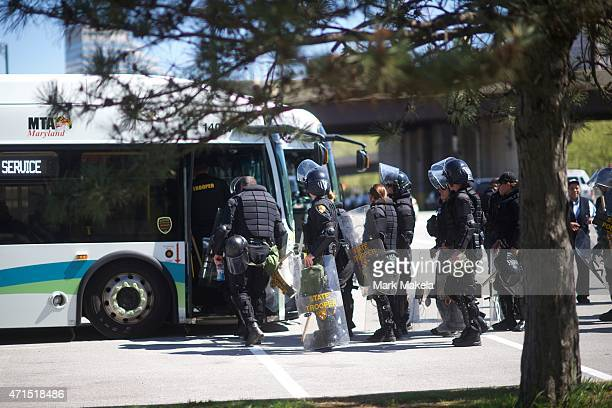 Baltimore riot police line up to board a bus following days of citywide riots and protests regarding the death of Freddie Gray on April 29 2015 in...