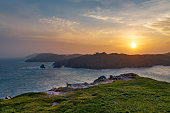 Sunset at the entrance to Baltimore Harbor, West Cork, Ireland.