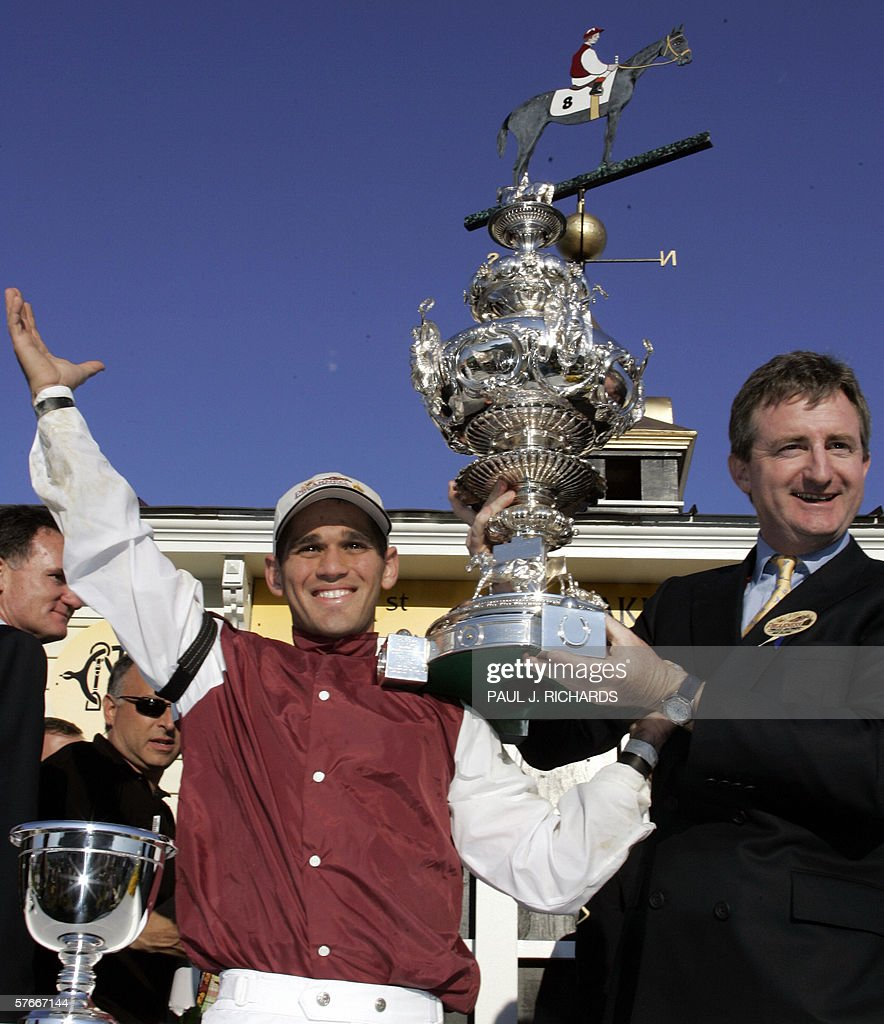 Bernardini jockey Javier Castellano and a representative from Darley Stabes hold the Woodlawn Vase in the winner's circle after winning the 131st...