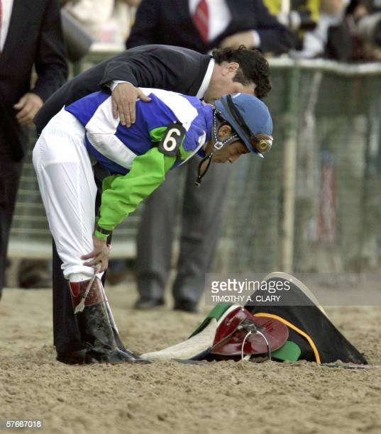 Jockey Edgar Prado is consoled after his horse Kentucky Derby winner Barbaro injured his right hind leg coming into the 1st turn at the 131st...