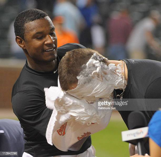 Baltimore's Adam Jones gives a shavingcream pie to gamewinning pitcher Jake Arrieta after the Orioles' 43 victory over the New York Yankees at Oriole...