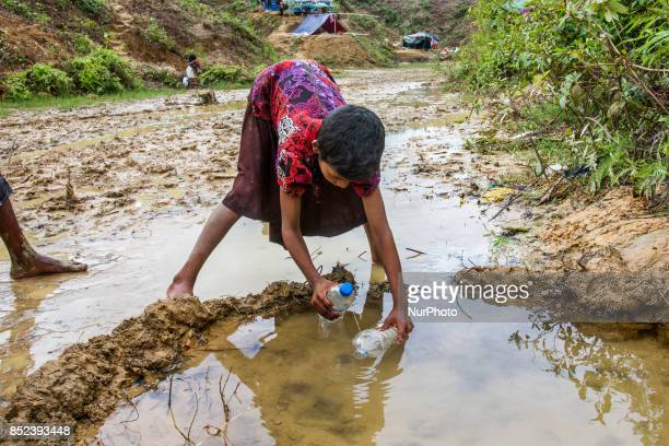 Balukhali camp resident collects drinking water from mud and clay as the supply of drinking water is inadequate They dug a 3 to 4 feet circular or...