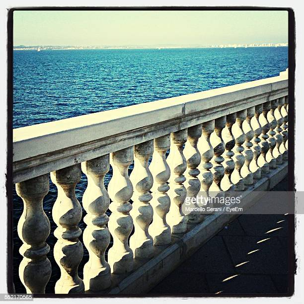 Balustrade On Edge Of Calm Sea