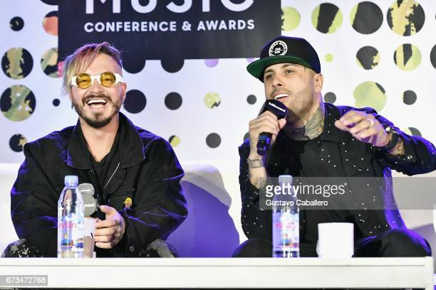 Balvin and Nicky Jam speak at the Billboard Latin Conference 2017 at Ritz Carlton South Beach on April 26 2017 in Miami Beach Florida