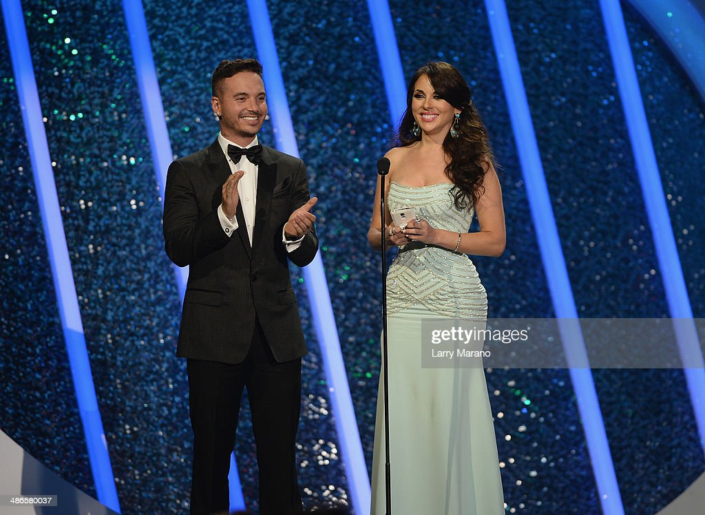 Balvin and Vanessa Villela present onstage during the 2014 Billboard Latin Music Awards at Bank United Center on April 24 2014 in Miami Florida