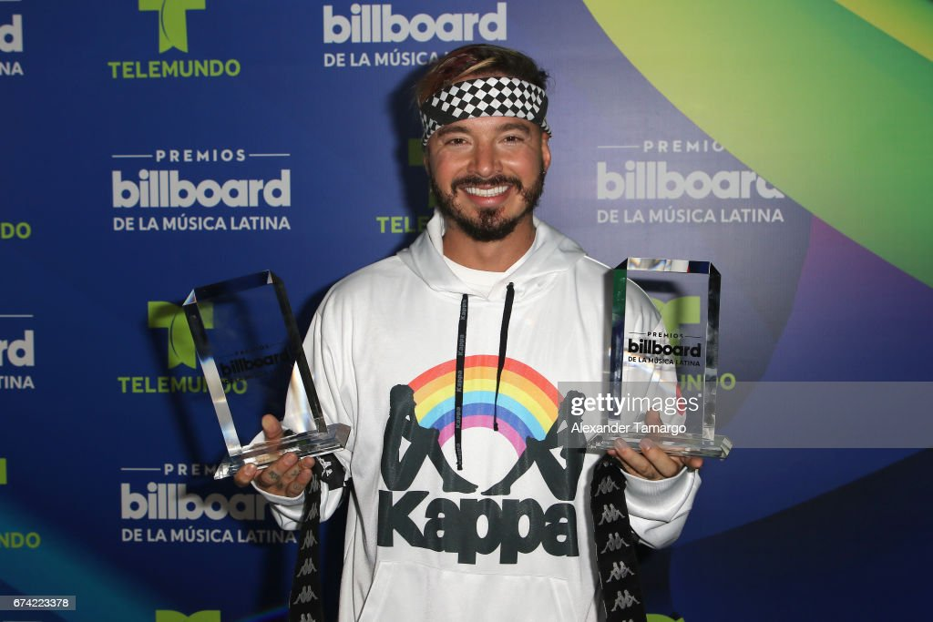 J Balvin poses with awards in the press room during the Billboard Latin Music Awards at Watsco Center on April 27, 2017 in Coral Gables, Florida.