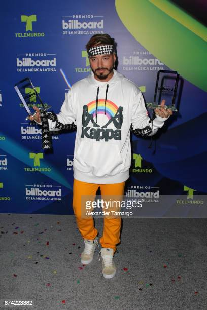 Balvin poses with awards in the press room during the Billboard Latin Music Awards at Watsco Center on April 27 2017 in Coral Gables Florida