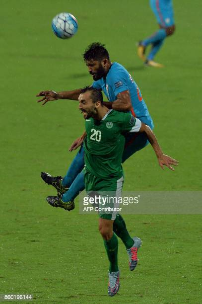 Balwant Singh of India and Carlos Leonel Fernandes head the ball during the 2019 AFCAsian Cup qualifying match between India and Macau held at the...