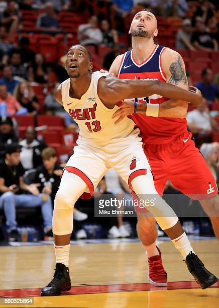 Bam Adebayo of the Miami Heat boxes out Marcin Gortat of the Washington Wizards during a preseason game at American Airlines Arena on October 11 2017...