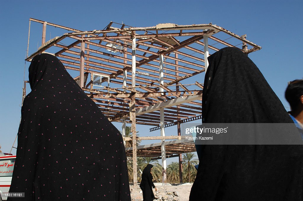 People pass by the skeleton of a building that survived the earthquake in Bam Iran 6th November 2004 The 2003 Bam earthquake was a major earthquake...