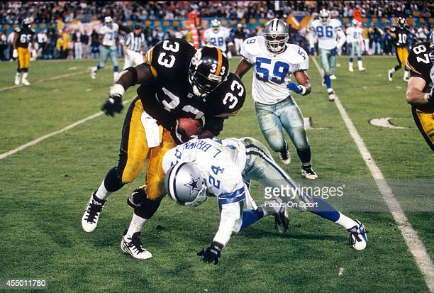 Bam Morris of the Pittsburgh Steelers carries the ball and gets hit by Larry Brown of the Dallas Cowboys during Super Bowl XXX on January 28 1996 at...