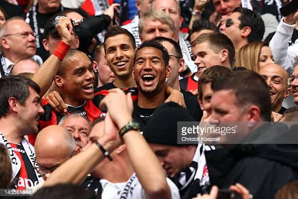 Bamba Anderson and Habib Bellaid of Frankfurt celebrate the ascent to the 1 Bundesliga aft the Second Bundesliga match between Eintracht Frankfurt...