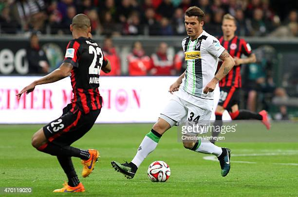 Bamba Anderson of Eintracht Frankfurt and Granit Xhaka of Borussia Moenchengladbach battle for the ball during the Bundesliga match between Eintracht...