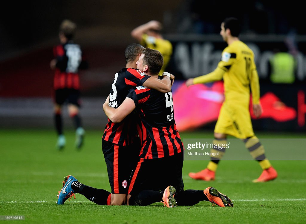Bamba Anderson of Eintracht Frankfurt and team mate <a gi-track='captionPersonalityLinkClicked' href=/galleries/search?phrase=Marco+Russ&family=editorial&specificpeople=653868 ng-click='$event.stopPropagation()'>Marco Russ</a> celebrate as Haris Seferovic (not in picture) scores their second goal during the Bundesliga match between Eintracht Frankfurt and Borussia Dortmund at Commerzbank-Arena on November 30, 2014 in Frankfurt am Main, Germany.
