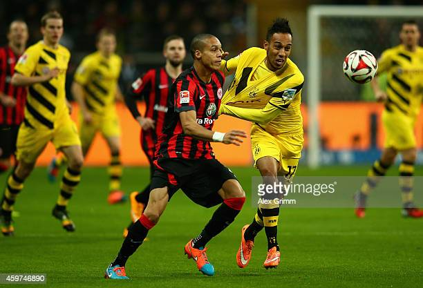 Bamba Anderson of Eintracht Frankfurt challenges PierreEmerick Aubameyang of Borussia Dortmund during the Bundesliga match between Eintracht...