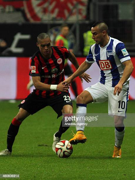 Bamba Anderson of Eintracht Frankfurt vies with Anis BenHatira of Hertha Berlin during the Bundesliga football match between Eintracht Frankfurt and...