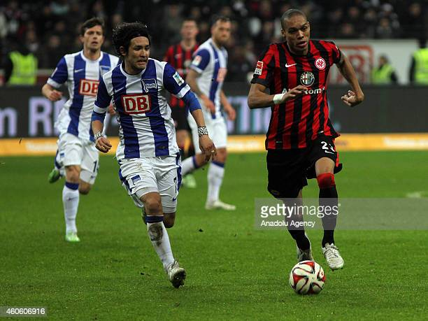 Bamba Anderson of Eintracht Frankfurt vies with Hajime Hosogai of Hertha Berlin during the Bundesliga football match between Eintracht Frankfurt and...