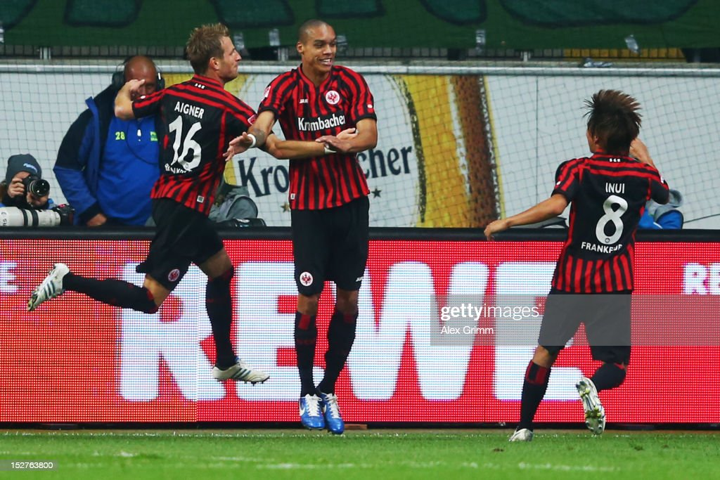 Bamba Anderson (C) of Frankfurt celebrates his team's third goal with team mates <a gi-track='captionPersonalityLinkClicked' href=/galleries/search?phrase=Stefan+Aigner&family=editorial&specificpeople=764034 ng-click='$event.stopPropagation()'>Stefan Aigner</a> (L) and <a gi-track='captionPersonalityLinkClicked' href=/galleries/search?phrase=Takashi+Inui&family=editorial&specificpeople=7174976 ng-click='$event.stopPropagation()'>Takashi Inui</a> during the Bundesliga match between Eintracht Frankfurt and Borussia Dortmund at Commerzbank-Arena on September 25, 2012 in Frankfurt am Main, Germany.