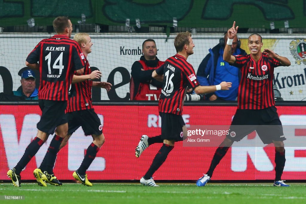 Bamba Anderson of Frankfurt celebrates his team's third goal with team mates <a gi-track='captionPersonalityLinkClicked' href=/galleries/search?phrase=Stefan+Aigner&family=editorial&specificpeople=764034 ng-click='$event.stopPropagation()'>Stefan Aigner</a>, Sebastian Rode and <a gi-track='captionPersonalityLinkClicked' href=/galleries/search?phrase=Alexander+Meier&family=editorial&specificpeople=615512 ng-click='$event.stopPropagation()'>Alexander Meier</a> (R-L) during the Bundesliga match between Eintracht Frankfurt and Borussia Dortmund at Commerzbank-Arena on September 25, 2012 in Frankfurt am Main, Germany.