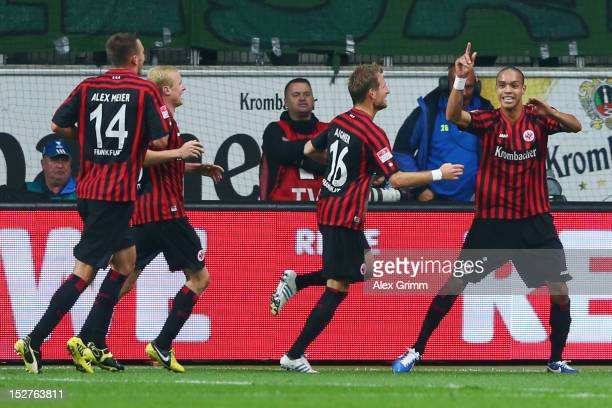 Bamba Anderson of Frankfurt celebrates his team's third goal with team mates Stefan Aigner Sebastian Rode and Alexander Meier during the Bundesliga...