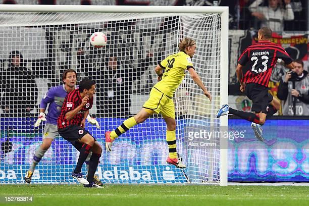 Bamba Anderson of Frankfurt scores his team's third goal against Marcel Schmelzer and goalkeeper Roman Weidenfeller of Dortmund during the Bundesliga...