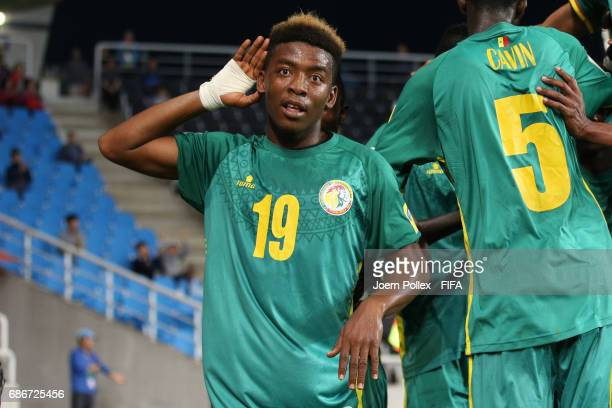 Bamba Kane of Senegal celebrates after his team mate Ibrahima Niane scored his team's first goal of Senegal compete for the ball during the FIFA U20...
