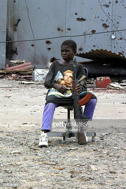 Bamba one of the child fighters of the LURD rebels rests 08 August 2003 in Viatown quarter of the Liberian capital Monrovia in a LURDheld zone...
