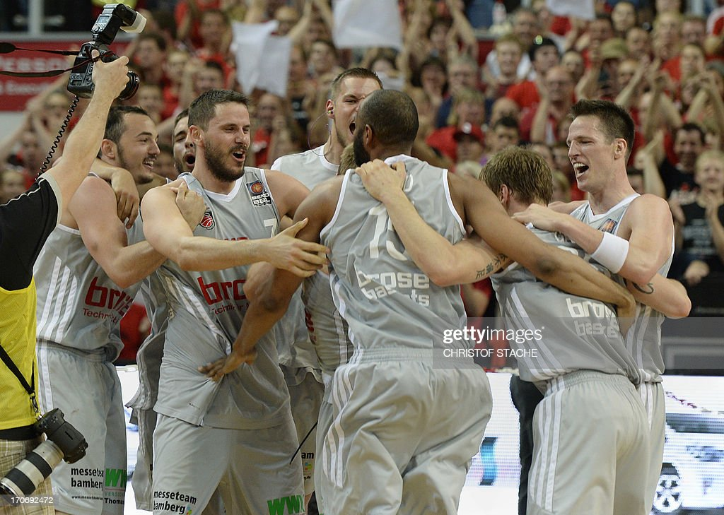 Bamberg team members celebrate after the German first division basketball Bundesliga final play off match between Brose Baskets Bamberg and EWE Baskets Oldenburg in Bamberg, southern Germany, on June 16, 2013. Bamberg won the match 91-88.