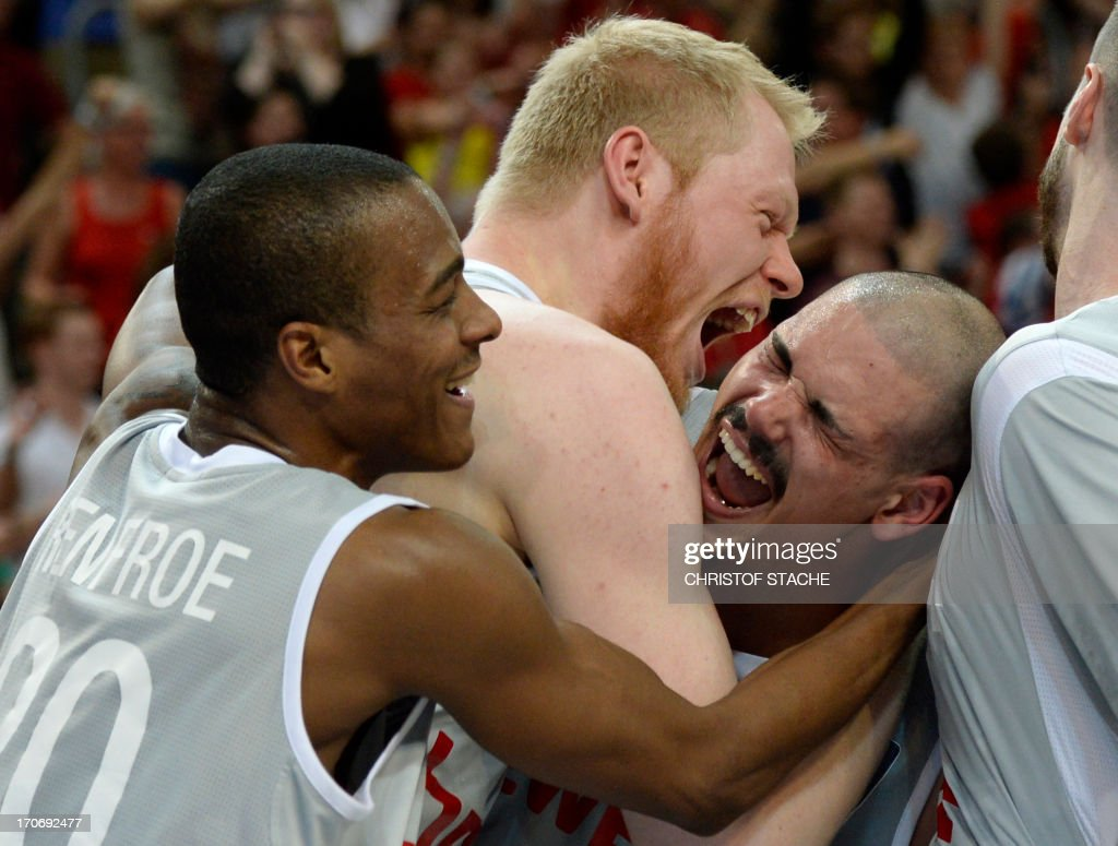 Bamberg's Alex Renfroe, Philipp Neumann and Maik Zirbes celebrate after the German first division basketball Bundesliga final play off match between Brose Baskets Bamberg and EWE Baskets Oldenburg in Bamberg, southern Germany, on June 16, 2013. Bamberg won the match 91-88.