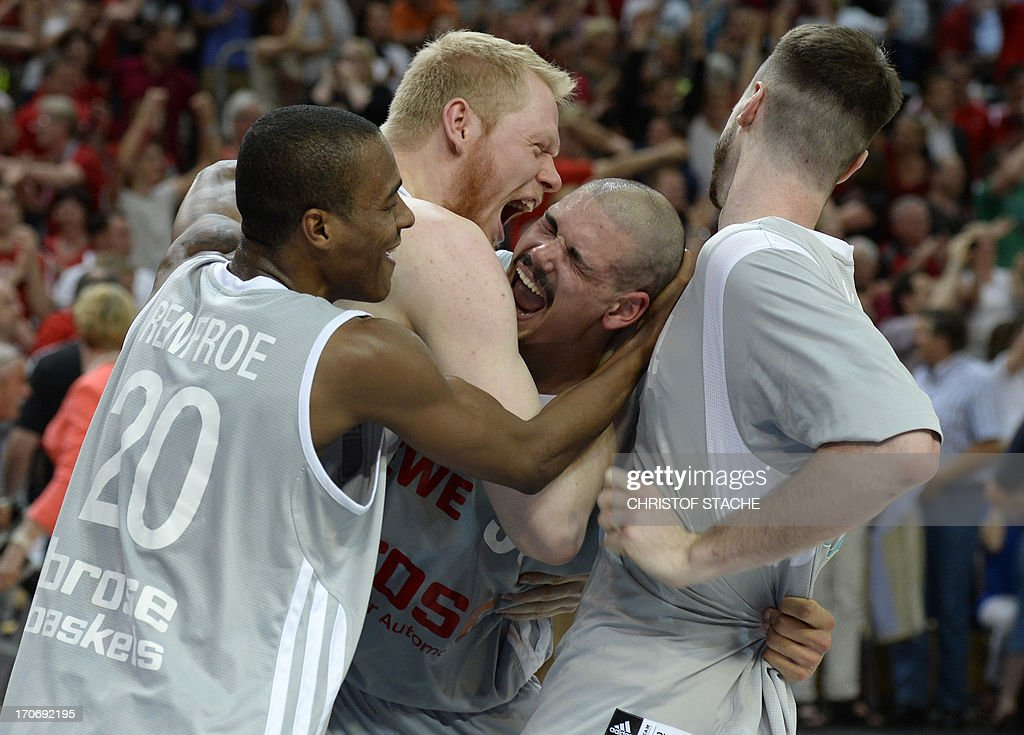 Bamberg's Alex Renfroe, Philipp Neumann, Maik Zirbes and Andrew James Ogilvy celebrate after the German first division basketball Bundesliga final play off match between Brose Baskets Bamberg and EWE Baskets Oldenburg in Bamberg, southern Germany, on June 16, 2013. Bamberg won the match 91-88.