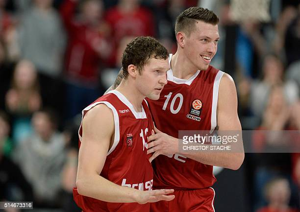 Bamberg's forward Daniel Theis and Bamberg's Latvian guard Janis Strelnieks react after the winner throw for Bamberg during the EuroLeague top 16...