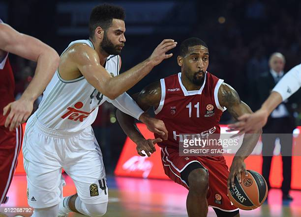 Bamberg's US guard Bradley Wanamaker and Madrid's Swedish forward Jeffrey Taylor vie for the ball during the EuroLeague Group F basketball match...