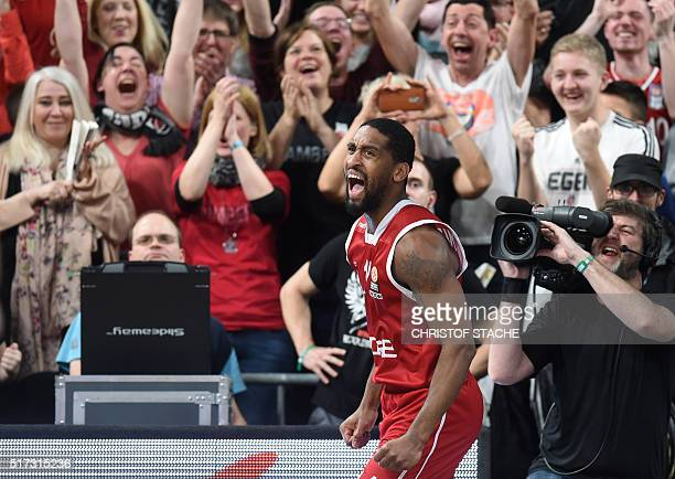 Bamberg's US guard Bradley Wanamaker celebrates after his last game point's for Bamberg during the EuroLeague top 16 Group F basketball match Brose...