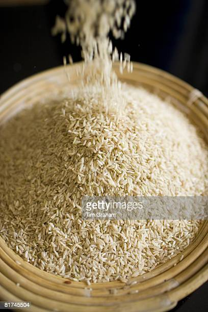 Bamboo basket of brown wholegrain rice Rice has become an expensive commodity as its in short supply