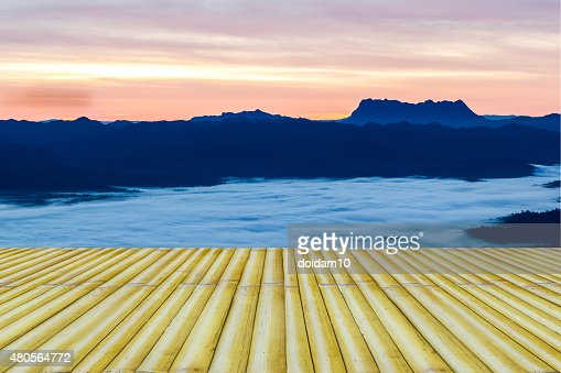 Bamboo bench terrace with the morning mist natural mountain view : Stock Photo