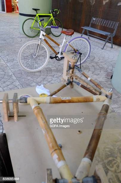 A bamboo bicycle frame seen being manufactured on the table