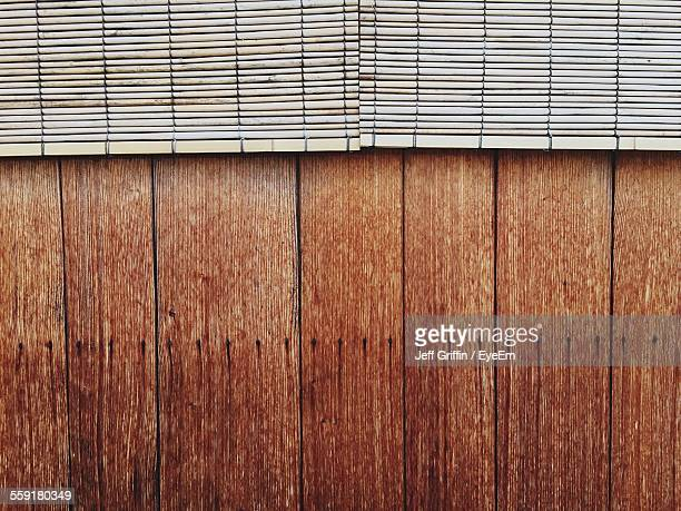 Bamboo Blinds On Wooden Wall