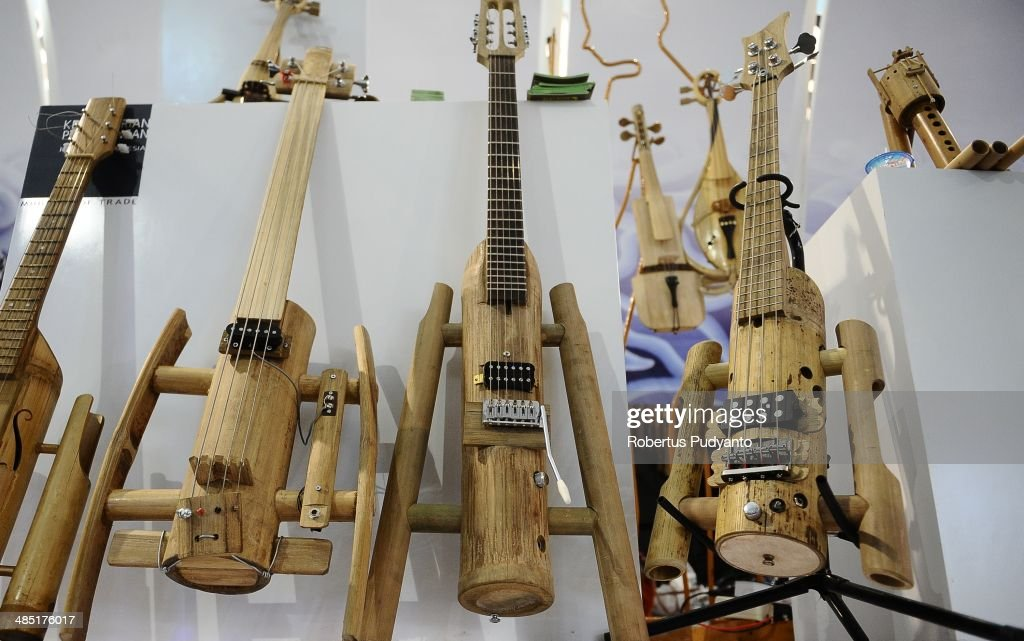 Bamboo guitars are displayed at the Indonesian Bamboo Community workshop on April 17, 2014 in Bandung, Java, Indonesia. Adang Muhidin, founder of Indonesian Bamboo Community, and his friends make sustainable bamboo musical instruments (guitar, violin, bass, trumpet, clarinet, saxophone, drums) a nod to the rise of the creative economy in Indonesia.