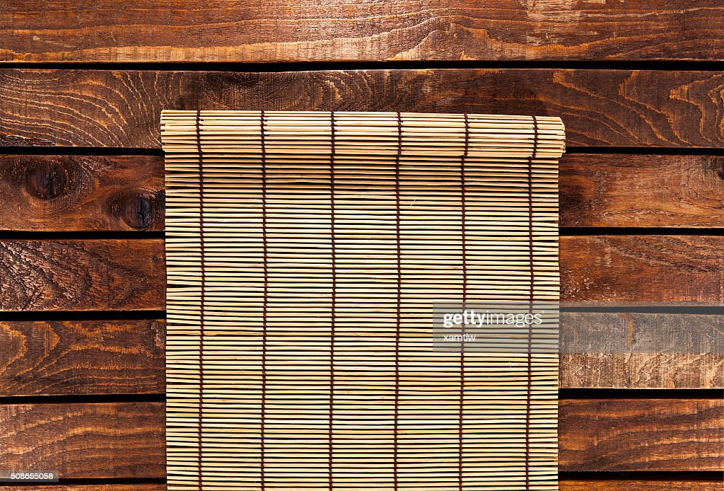 bamboo mat on wooden table. top view : Stock Photo