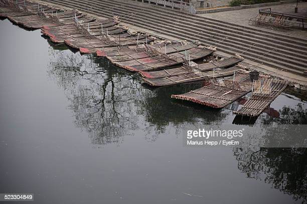Bamboo Rafts Moored On Riverbank