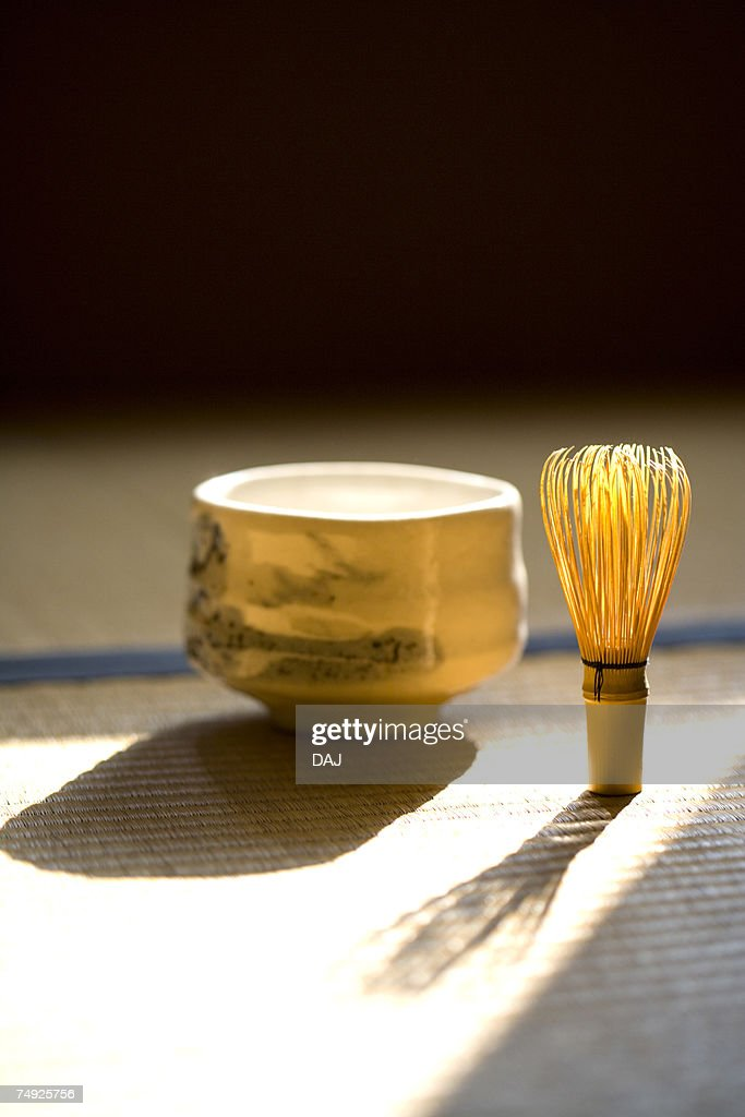 Bamboo Whisk and a Ceramic Bowl on Tatami : Stock Photo